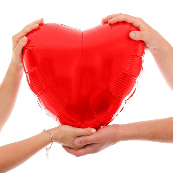 hands holding red heart e1423772538548 Yoga for Healthy Hearts on Valentines Day
